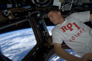 Reid enjoys the view from the Cupola on the International Space Station.
