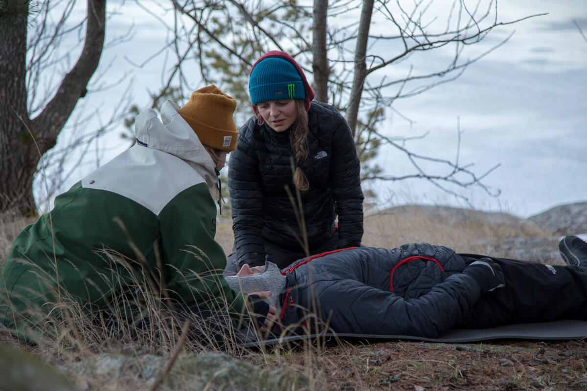 Rescuers assess incapacitated patient in winter