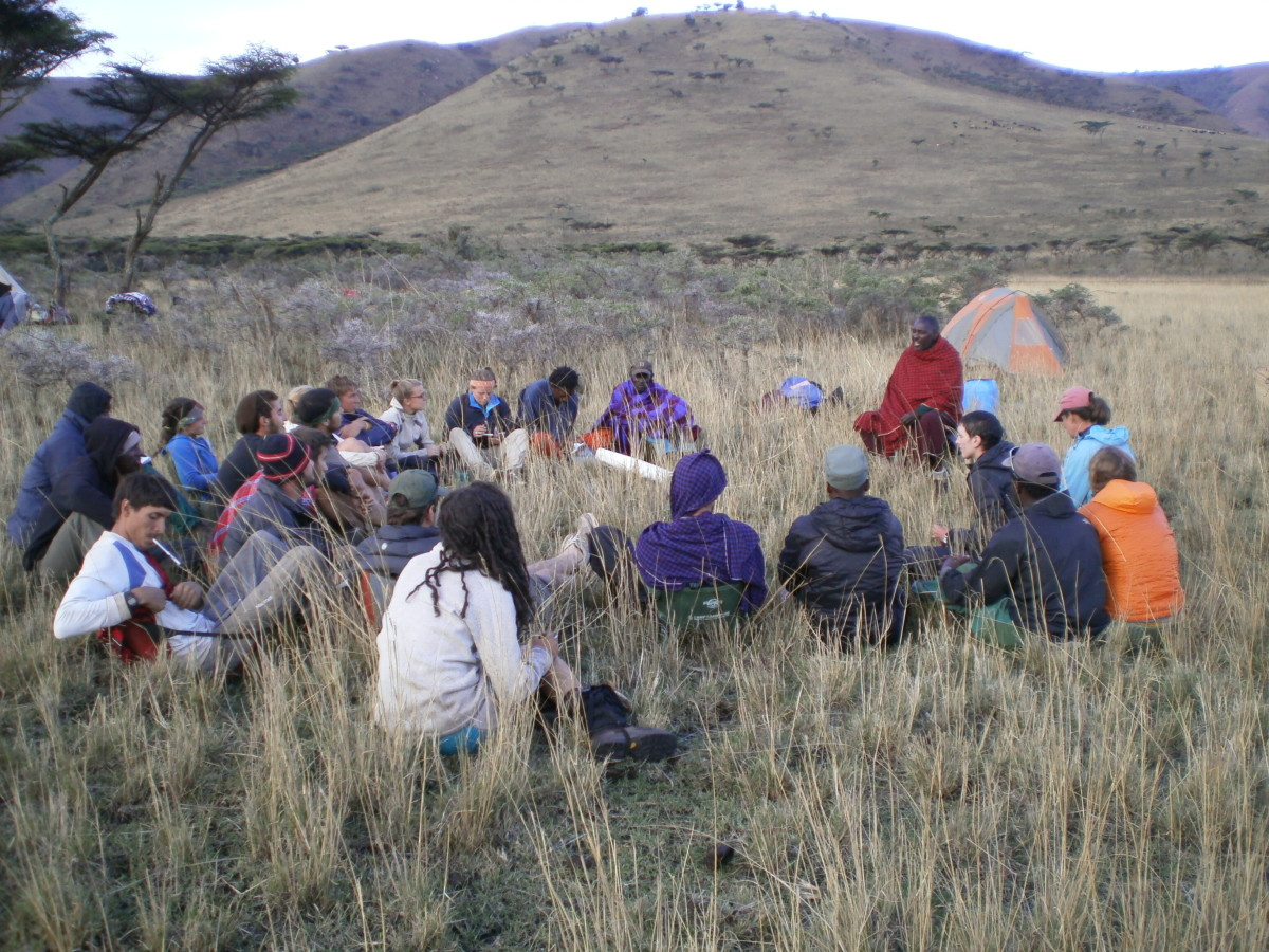NOLS group learning from Maasai member in Tanzania
