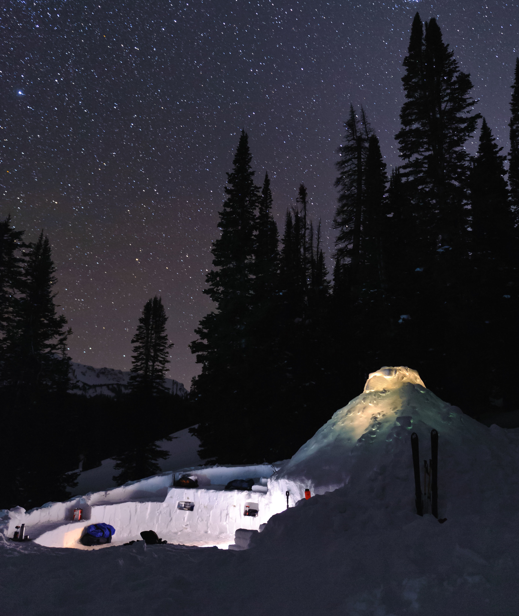 NOLS snowshelter and snow kitchen on a winter night in the Wyoming Range