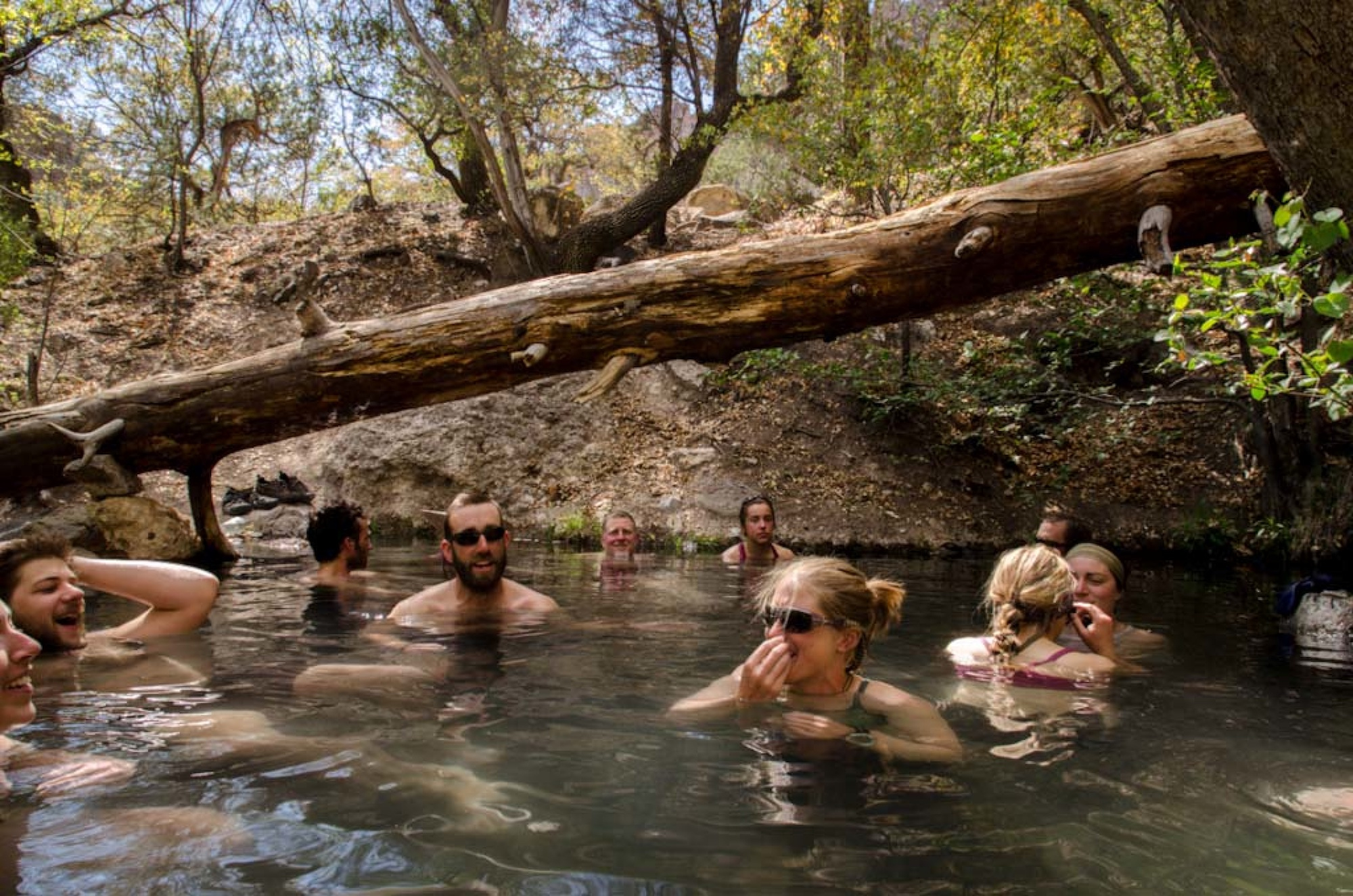 NOLS participants enjoying a hot spring in the Gila Wilderness