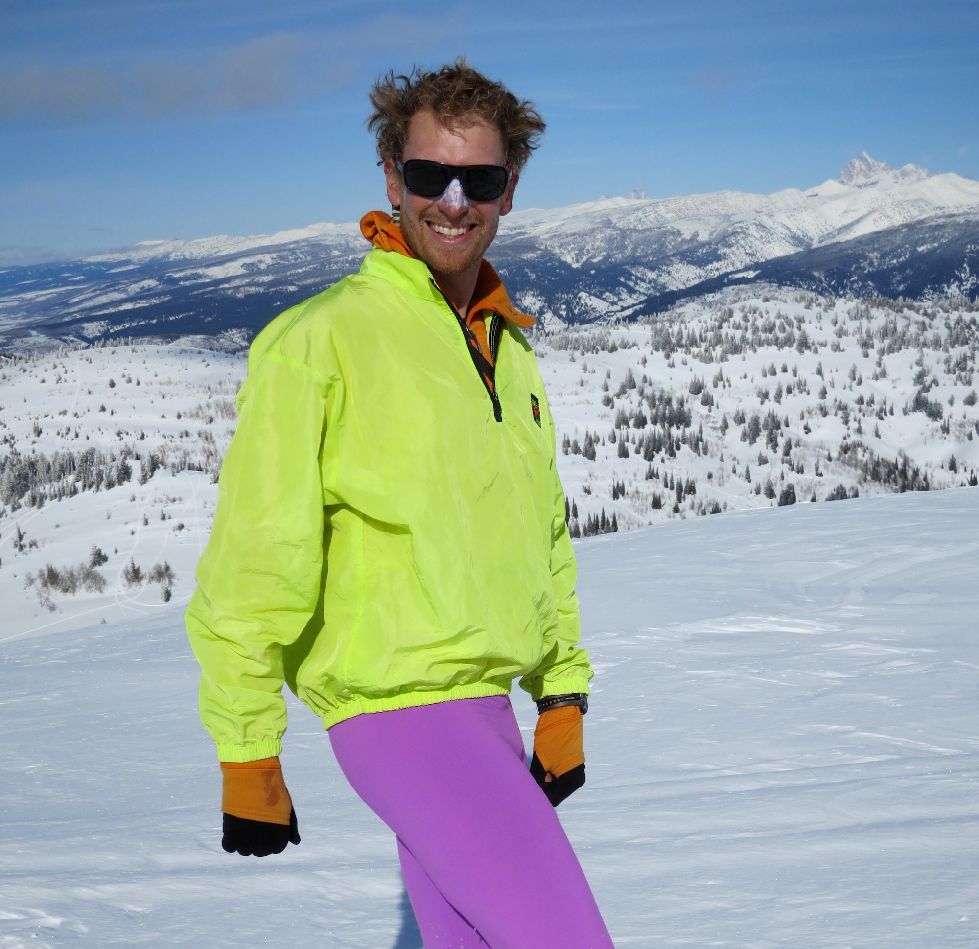 NOLS participant with fluorescent jacket and brightly colored tights models winter fashion