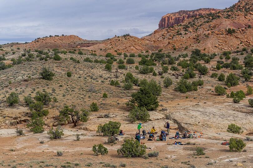 Group in a circle at camp in the canyonlands