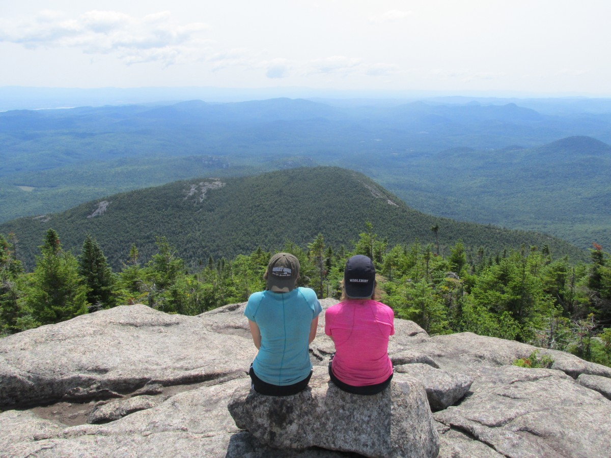 Two students take a break while backpacking in the Adirondacks
