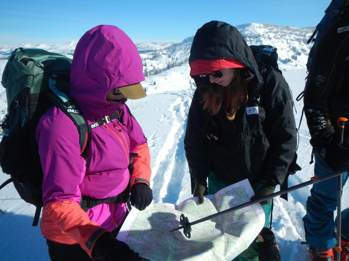 Group stops to read the map while ski touring