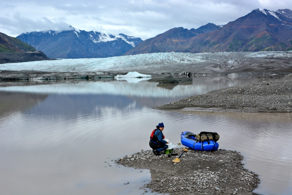 tim-kelley-Instructor Kristen Hayes packing up her boat at the toe of the Chisana Glacier..jpg