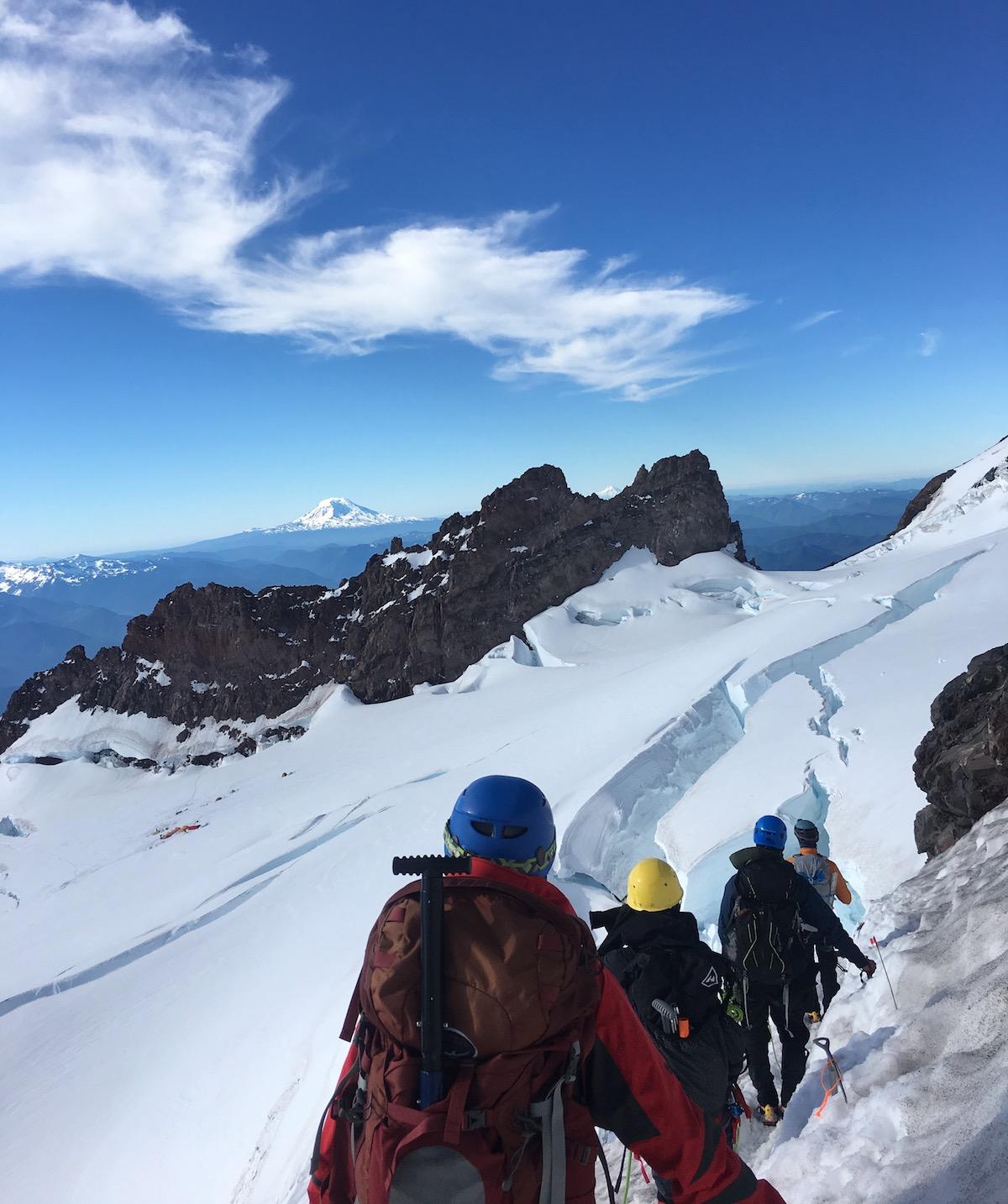 A rope team treks through the snow on Mt. Rainier