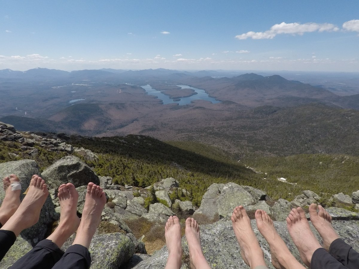 Airing out our feet at the top of a hill in the sun