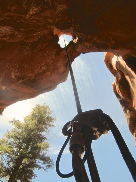 View looking up from a rappel in a canyon