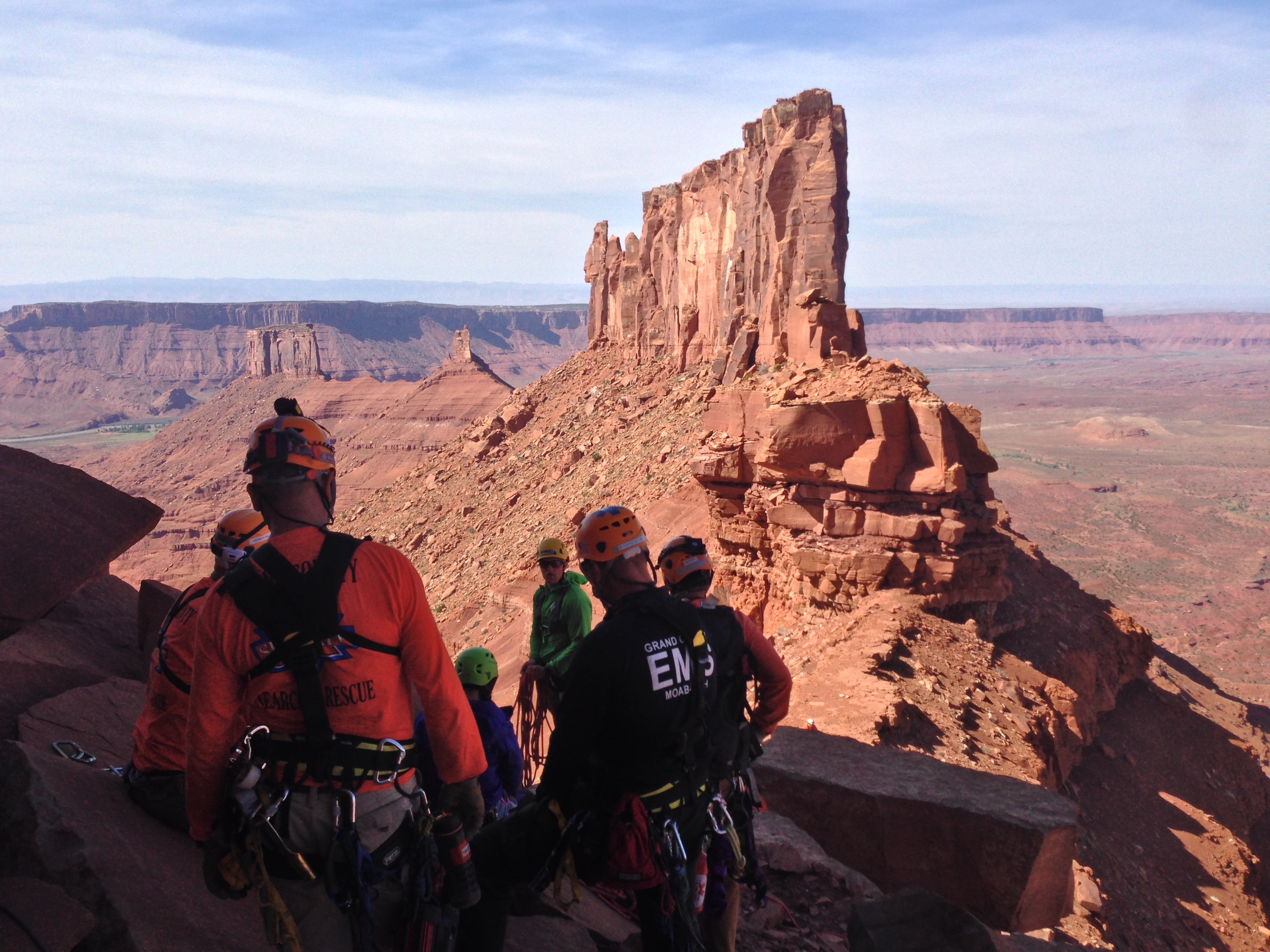 Rescue team assembled on the wall with iconic redrock spires in the background