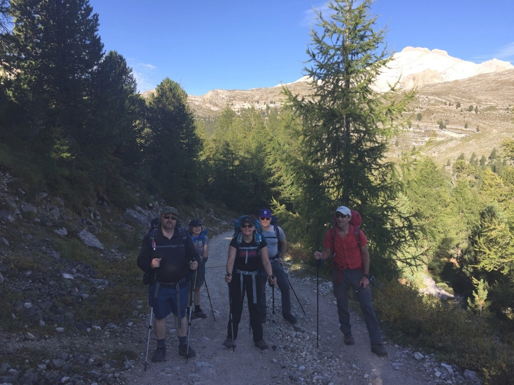 Group photo of hikers smiling on trail