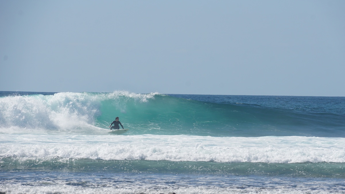 Surfer riding a wave in Baja California