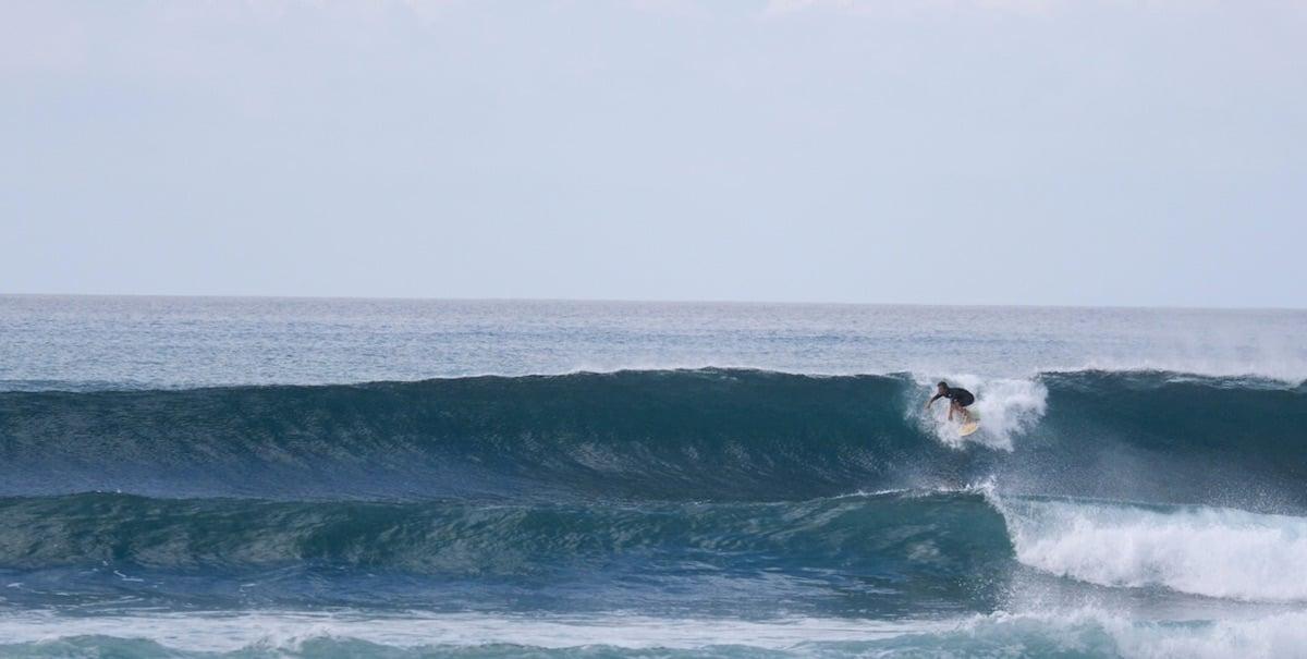 Surfer on waves in Baja California