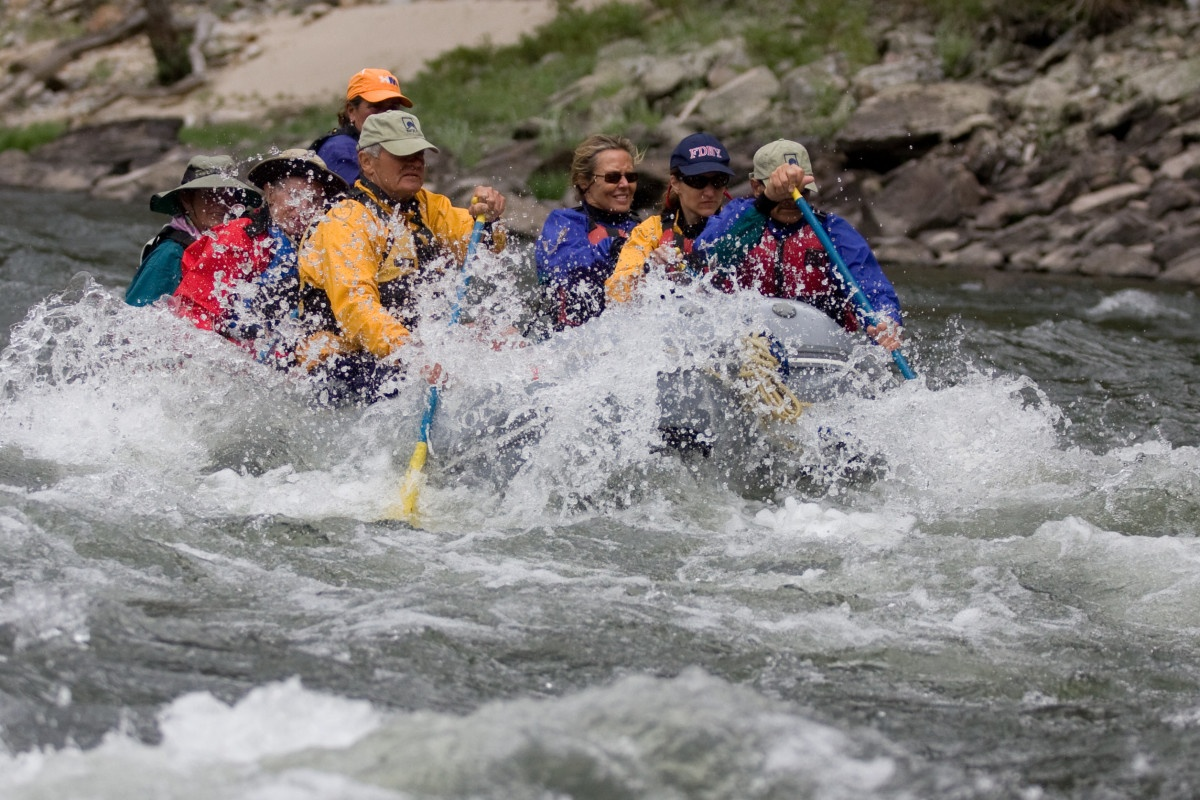 Team rafting through whitewater