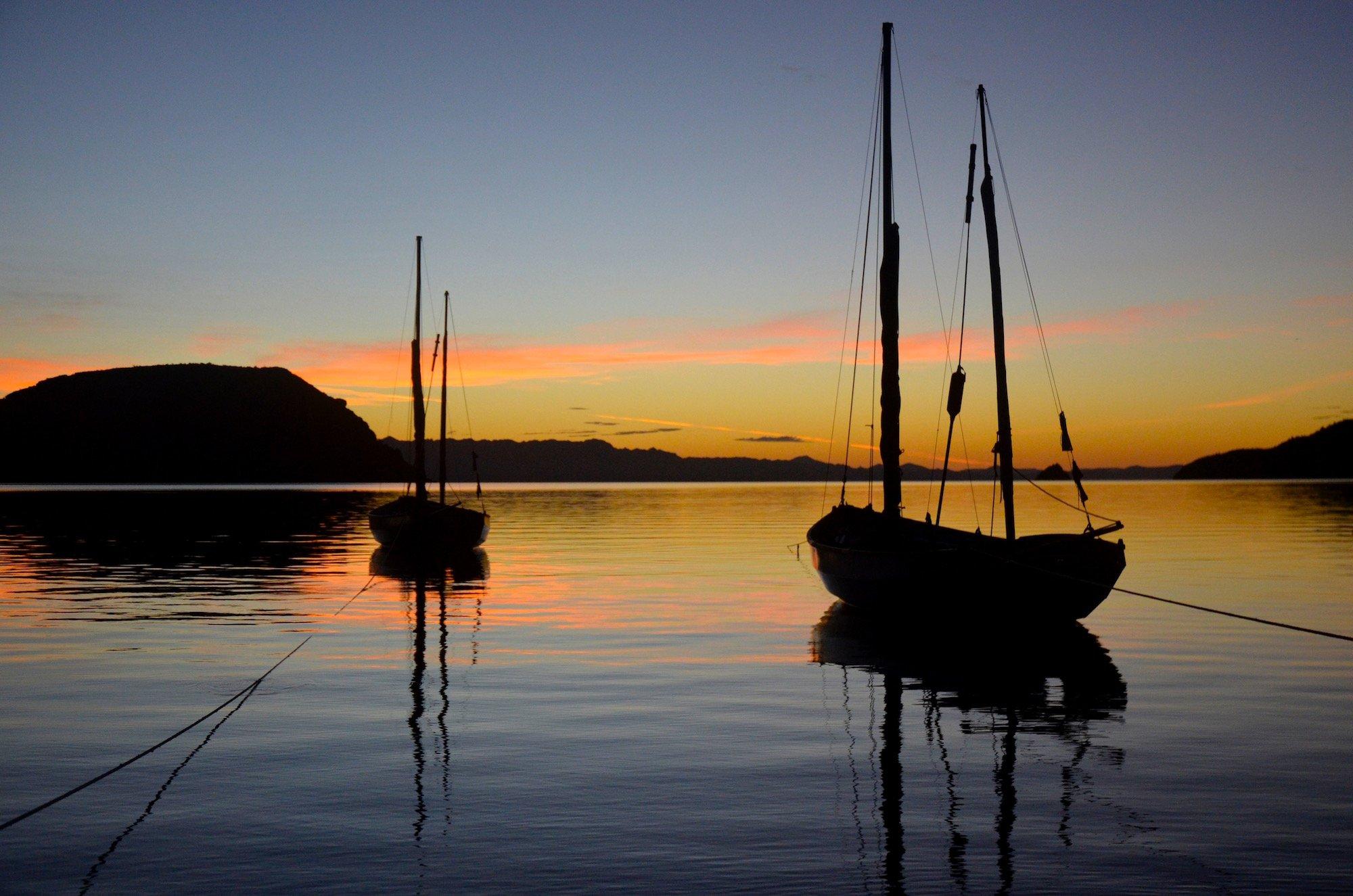 Two sailboats at sunset in Baja California