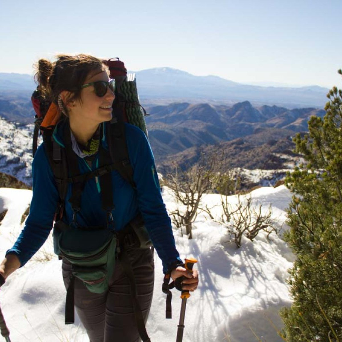 Woman hiking and smiling in the Southwest