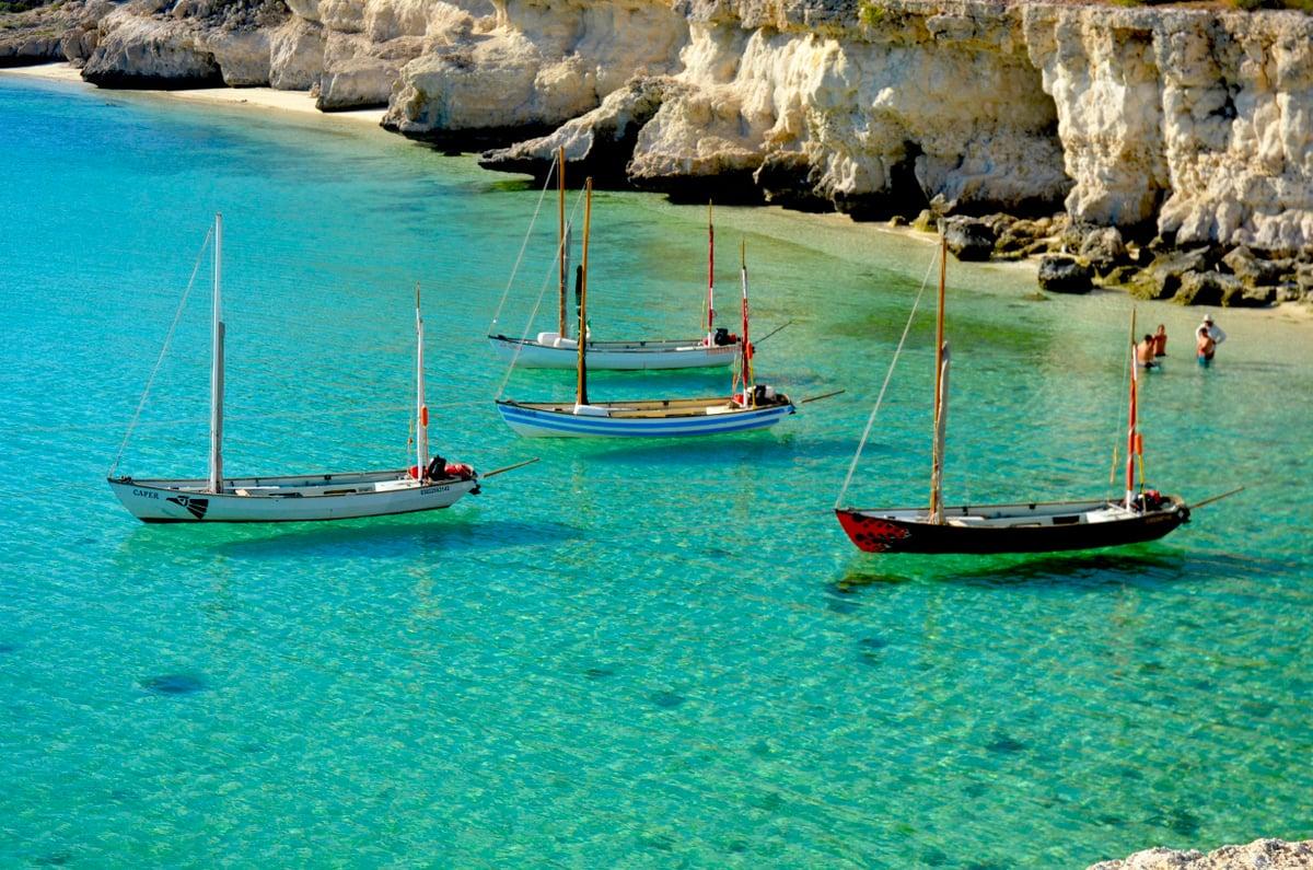 Four drascombe longboats anchored