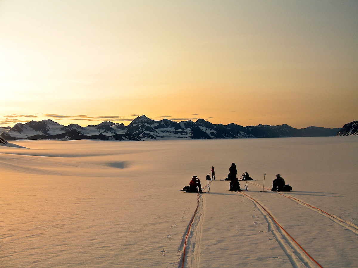 NOLS rope team pauses to rest while mountaineering in Alaska