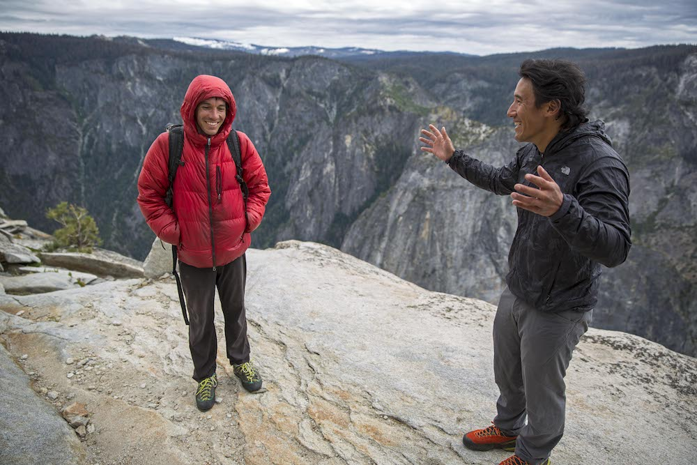 Alex Honnold and Jimmy Chin chat at the top of El Capitan after Honnold's unprecedented free solo climb