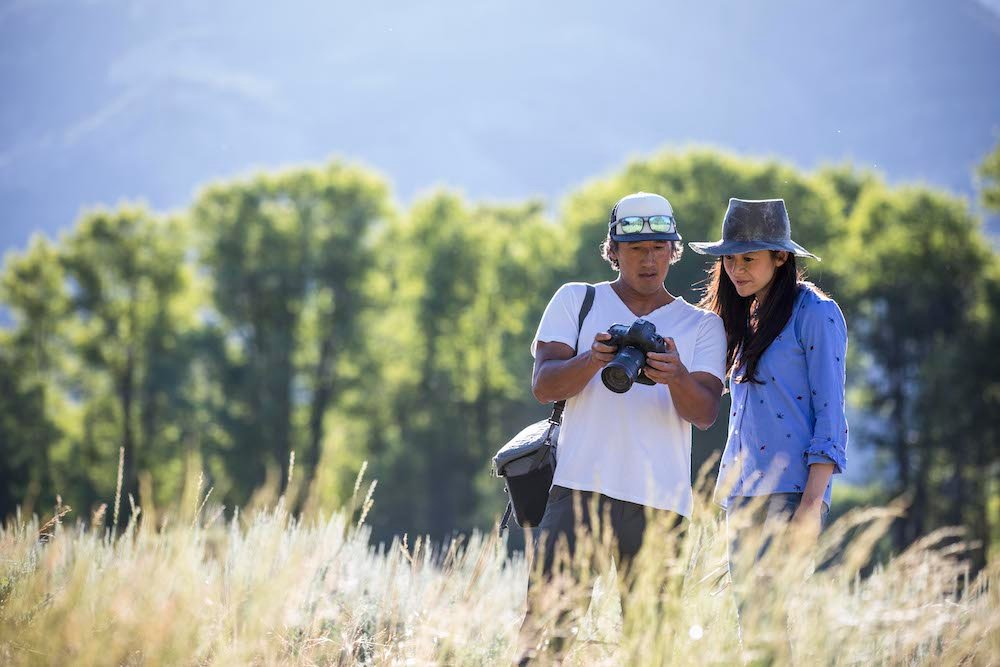 Jimmy Chin and E. Chai Vasarhelyi look at the latest shots on a camera in the field