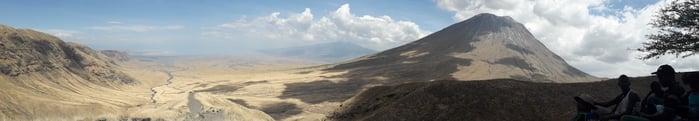 Panoramic scene with OldoinyoLengai mountain ion the horizon