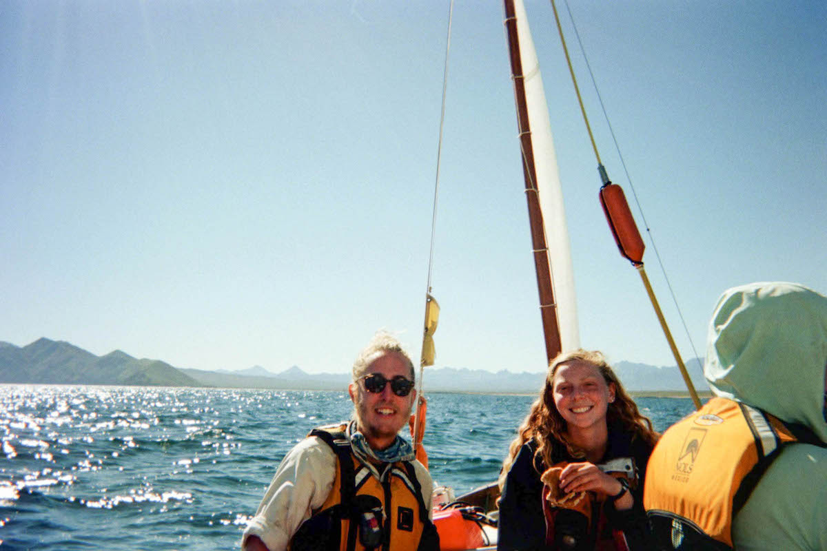 smiling NOLS students sailing in Mexico's Bay of Cortez