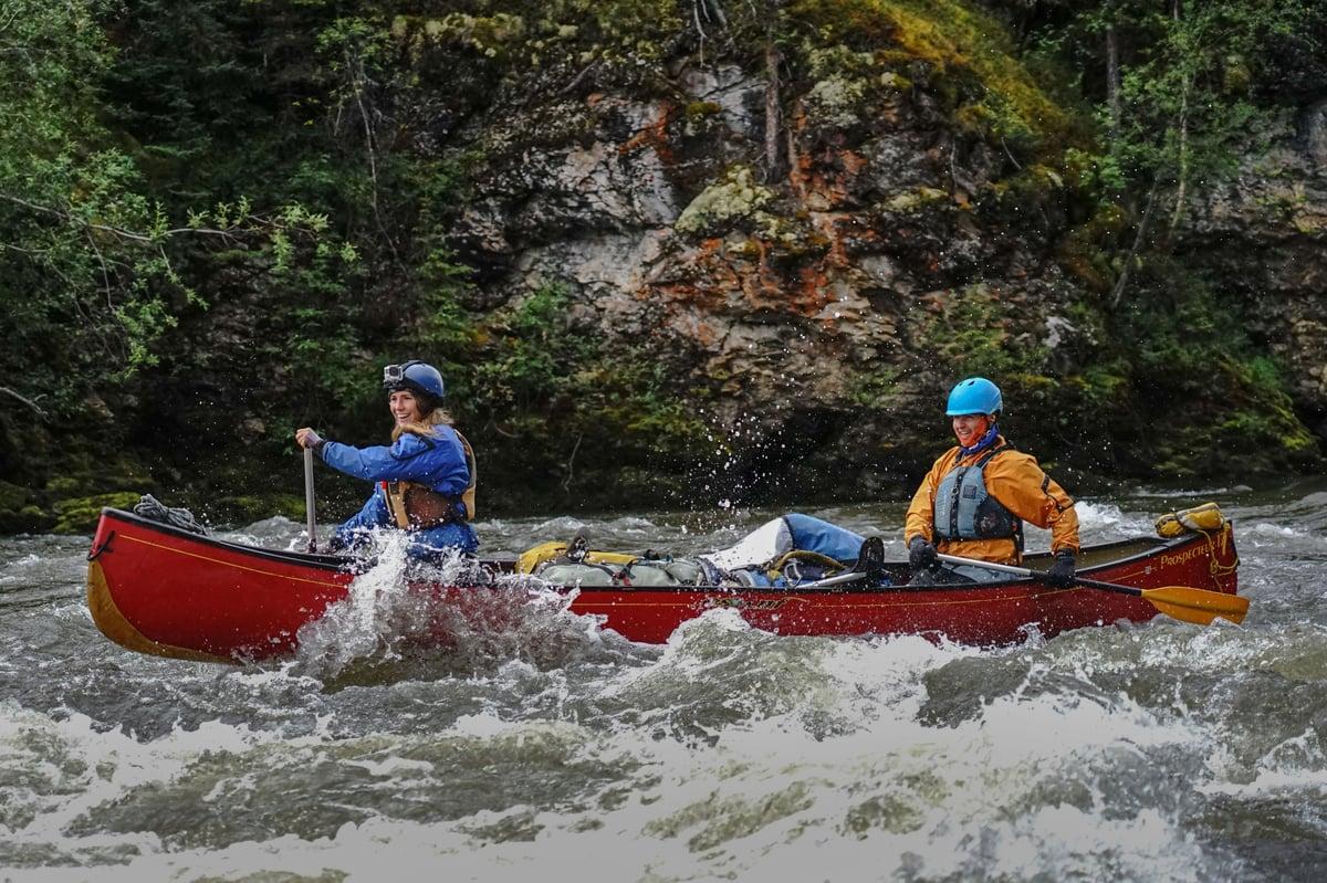 Students on a NOLS River Course navigate a river.