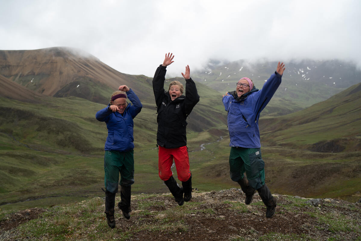 Students jump in the the Alaskan mountains.