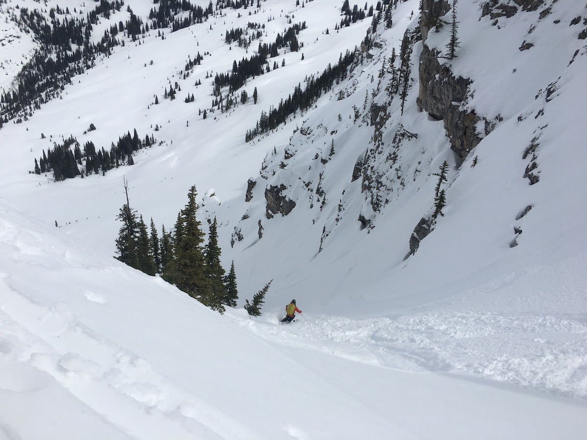 Person skiing down a snowy slope