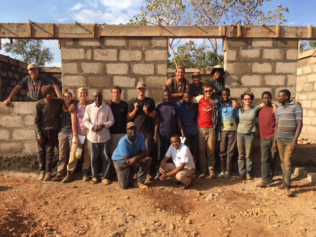 Steve's group with community members whose school they are helping build