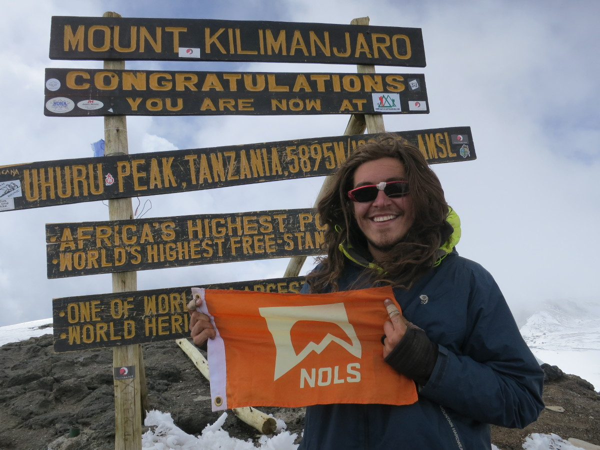 Steve on the summit of Kilimanjaro with a NOLS summit flag