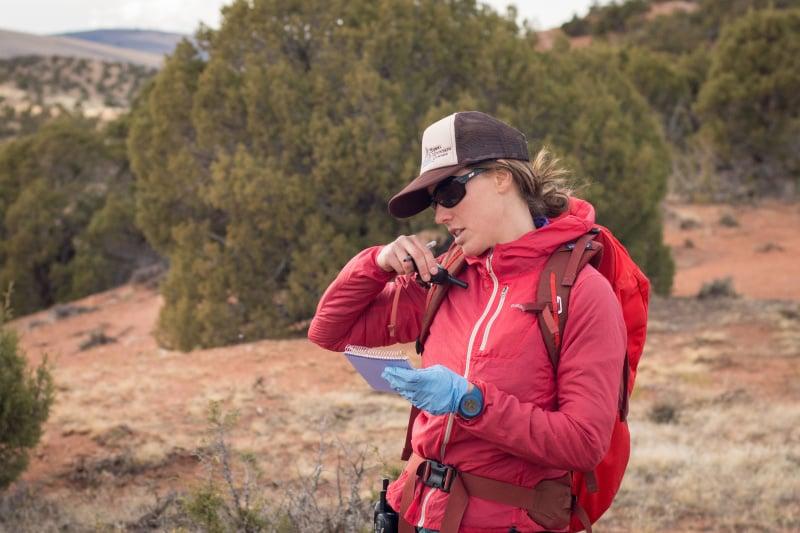 Woman talks on a walkie-talkie