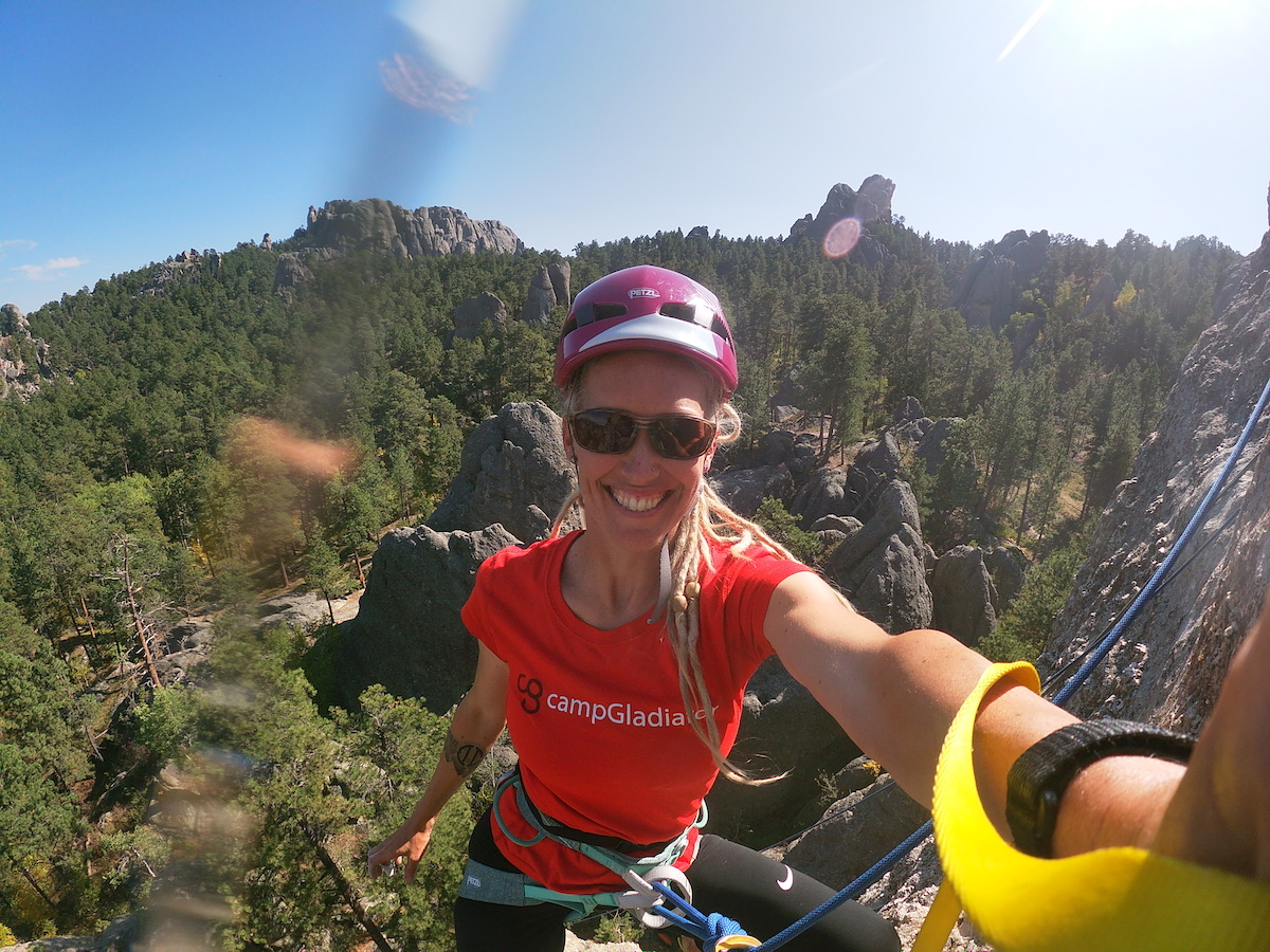 Eli takes a selfie during a climbing route