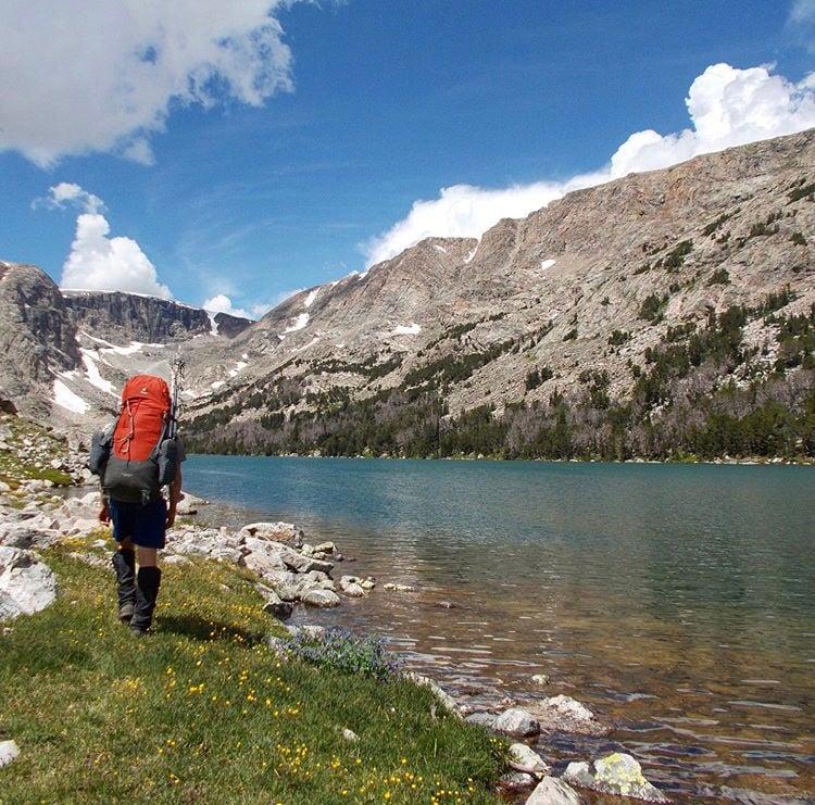 Backpacker along a lake in the Wind River Range