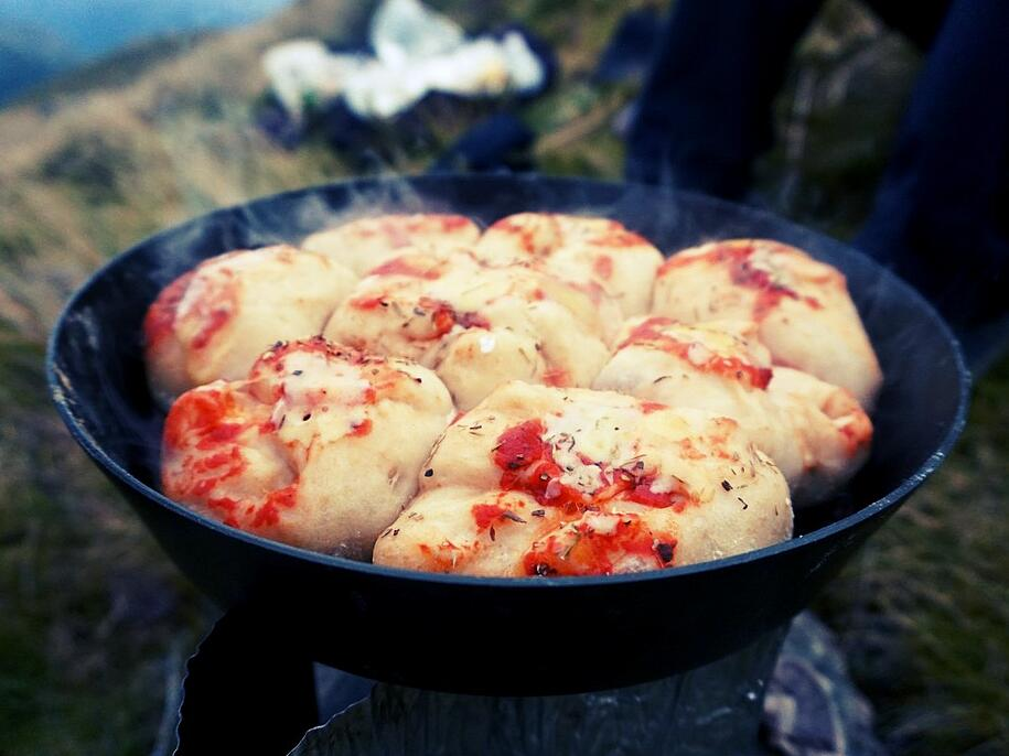 Steaming pan of hot mini calzones