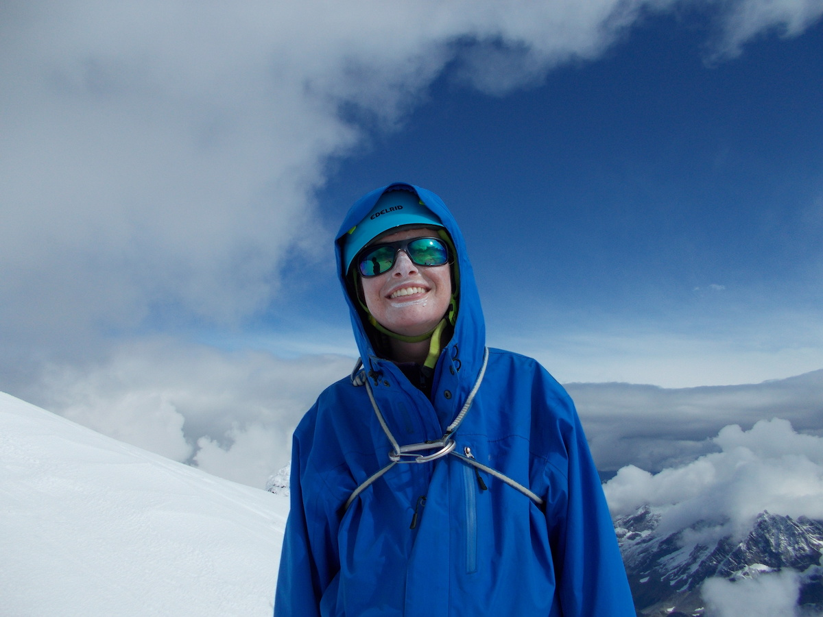 Author smiles wearing a mountaineering helmet