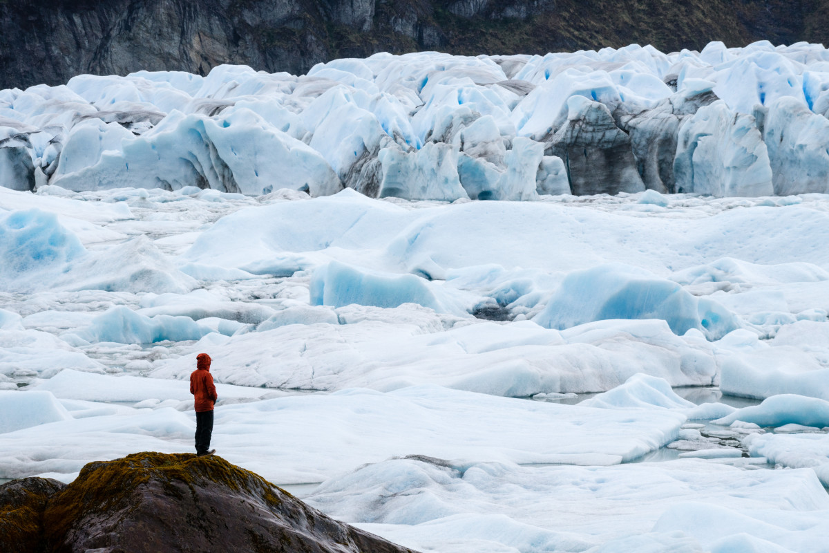Lone individual observes an intricate glacier field