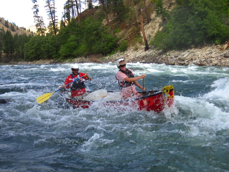 Two participants whitewater canoe on the Salmon River