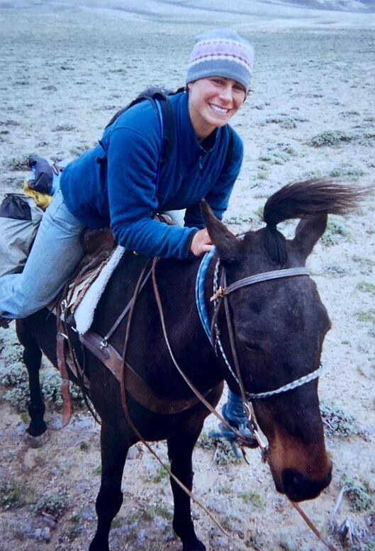 Erica smiles on horseback during the horsepacking section of her NOLS semester