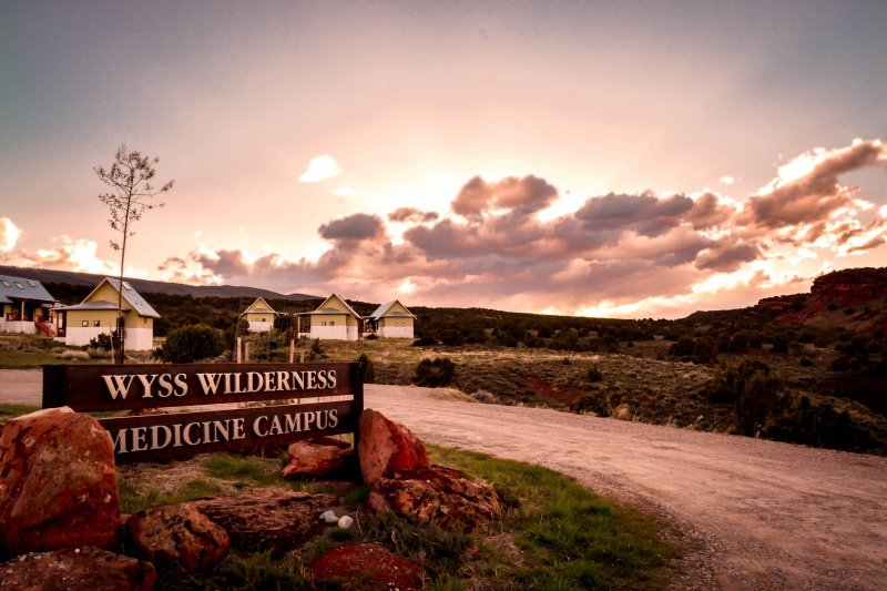 Photo of the housing and sign at the Wyss Wilderness Medicine Campus