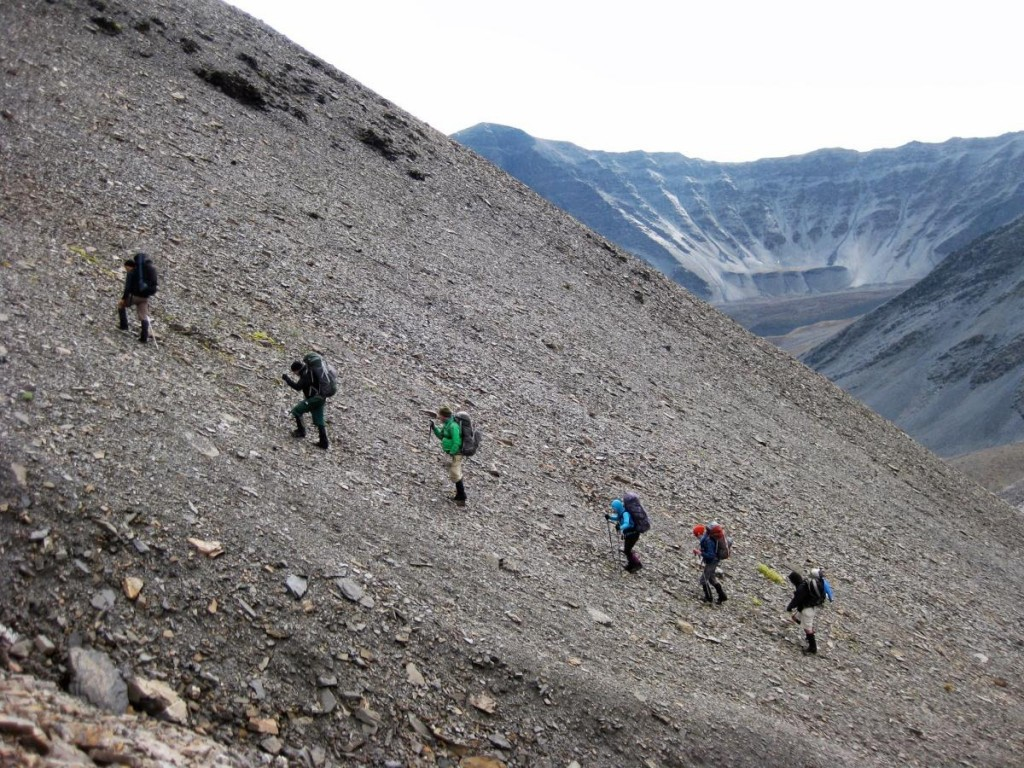 Climbing a scree slope in Alaska while backpacking