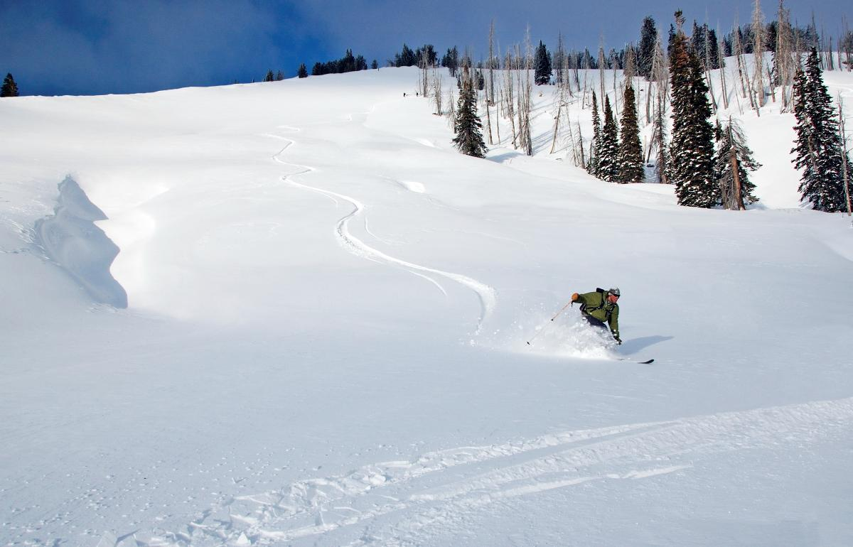 Single skier going down a slope