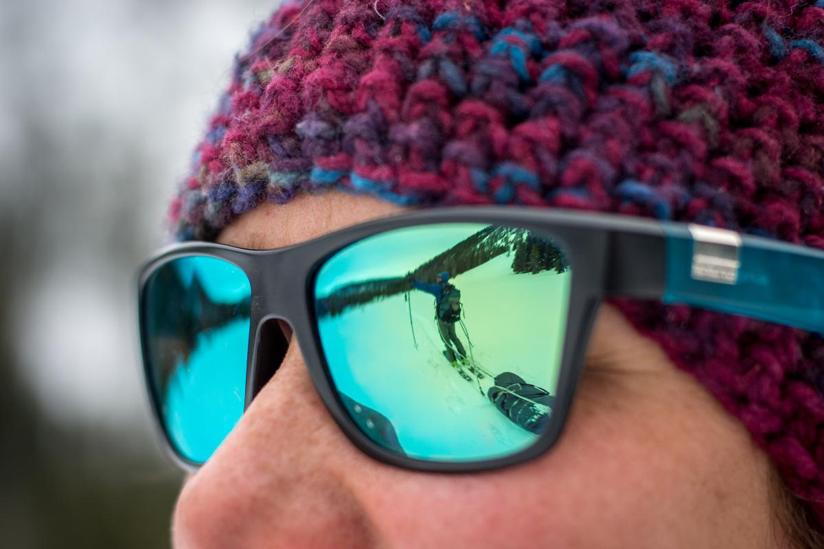 Close-up of person wearing sunglasses and knit hat