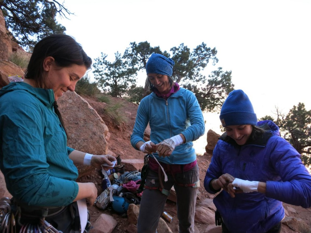group of women taping up to climb in Cochise Stronghold