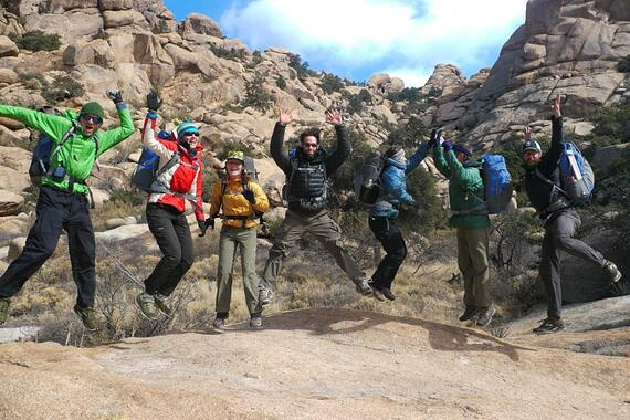 Hikers jump in unison