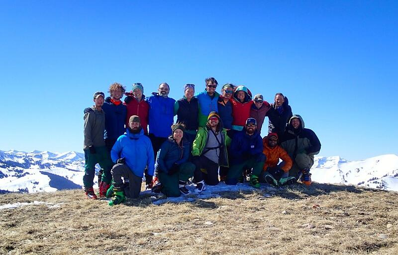 smiling NOLS semester students gather for a group photo in the Rocky Mountains