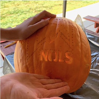 NOLS pumpkin in the process of being carved