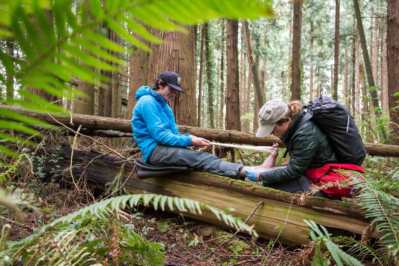 NOLS wilderness medicine student practices caring for patient in the outdoors