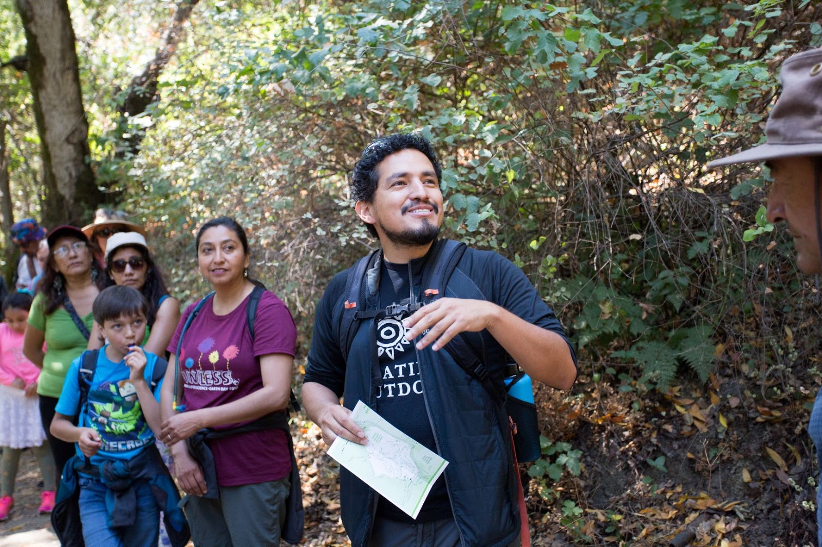 Photo of Jose Gonzalez leading a group on a hike for Latino Outdoors