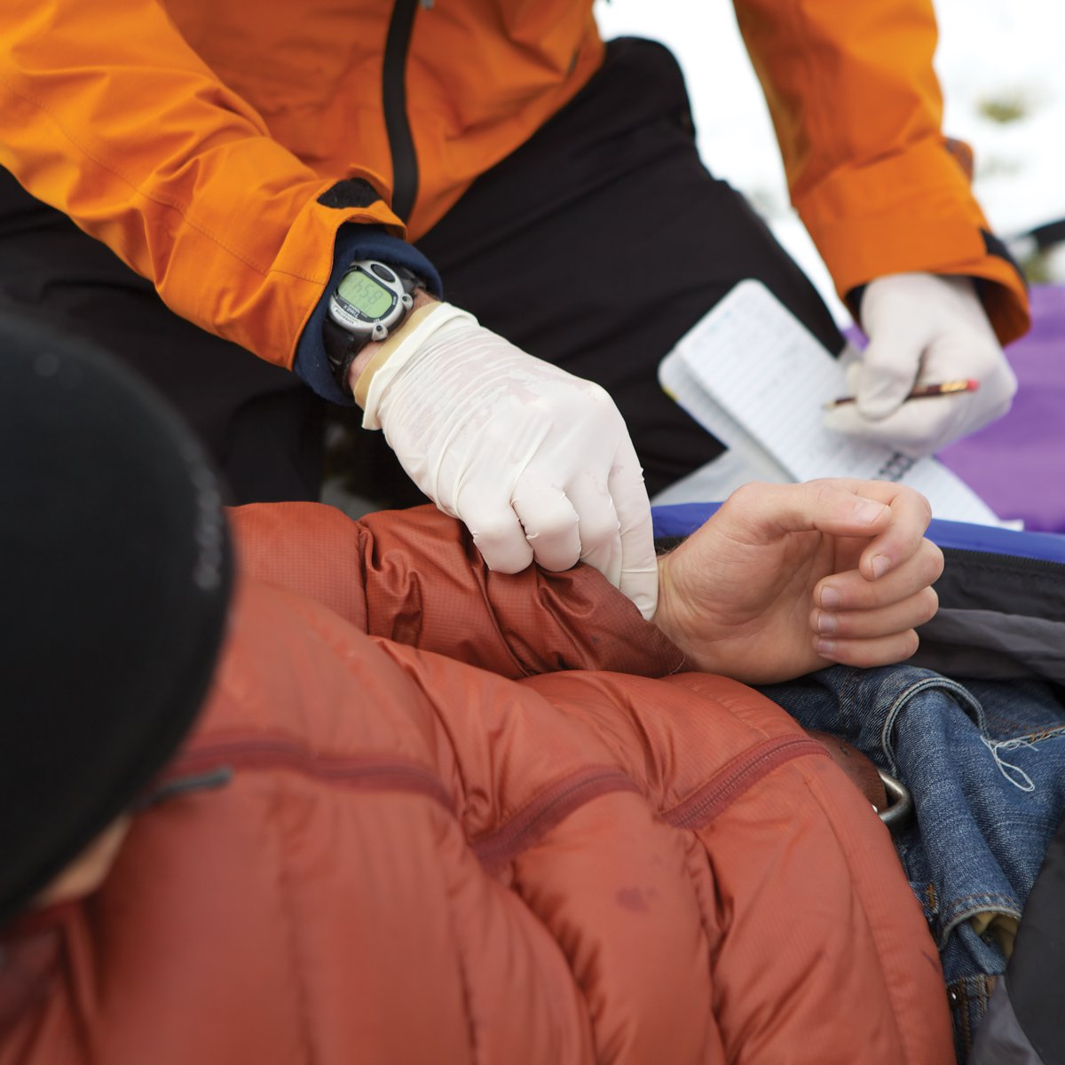 Checking a patient's pulse